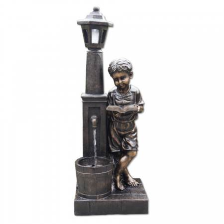 Boy Reading at Lamp