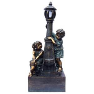 Playful Boy & Girl at Lamp